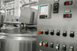 electronic control panel and tank at a milk factory. equipment at the dairy plant