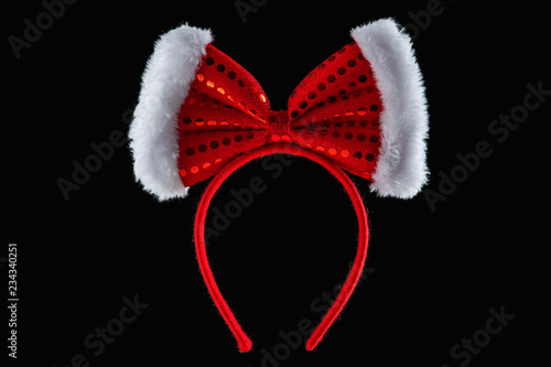 Red ribbon over tiara in shape of minnie mouse ears isolated Wallpaper Mural