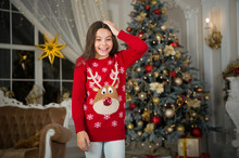 Christmas. Kid Enjoy The Holiday. The Morning Before Xmas. New Year Holiday. Happy New Year. Little Child Girl Likes Xmas Present. Small Happy Girl At Christmas. New Year New Me. Winter Fashion