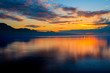 Beautiful colorful sunset in the autumn above the French Alps and Lake Geneva where the colors and clouds reflect beautifully.