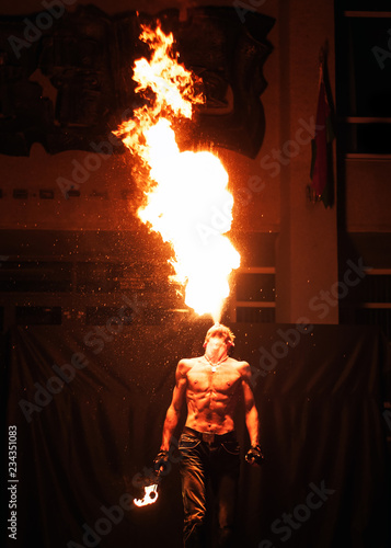 fire show, fire blowing performance, dancing with flame, male master fakir with fire works on street arts festival, fire breathing trick