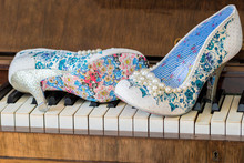 Brides Shoes On A Piano