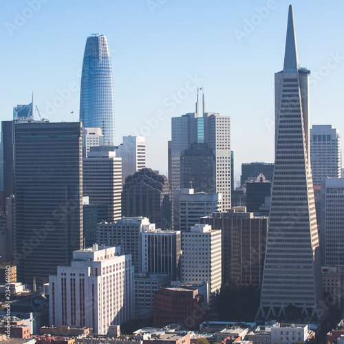 Beautiful super wide-angle aerial view of San Francisco, California, with Bay Bridge, Downtown, Ferry Market, and skyline scenery beyond the city, seen from the observation deck of Coit Tower