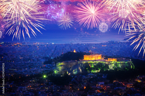 cityscape of Athens with illuminated Acropolis hill and Pathenon temple at night with fireworks, Greece