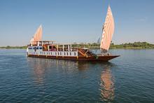 Large Egyptian Dahabeya River Boat Sailing On Nile