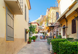 Fototapeta Uliczki - small cosy street of famous Placa old town district in Athens, Greece
