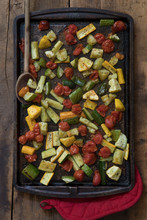Chopped Vegetables On A Baking Sheet