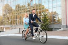 Couple Riding Tandem Bike On C...