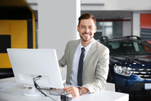 Salesman Working In Modern Car Dealership. Buying New Auto