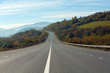 Landscape With Asphalt Road Leading To Mountains