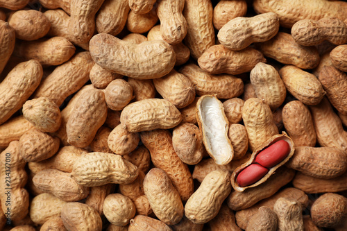 Dry peanuts in shell as background, top view. Healthy snack Wallpaper Mural