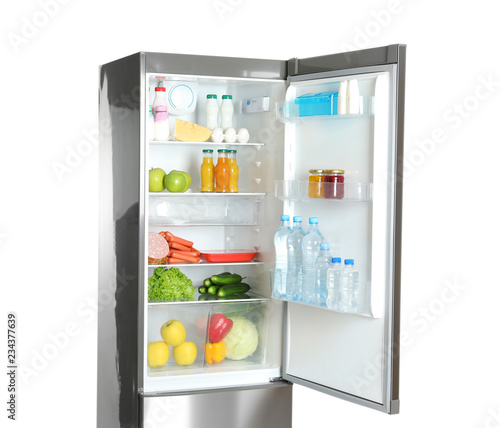 Open refrigerator with many different products on white background
