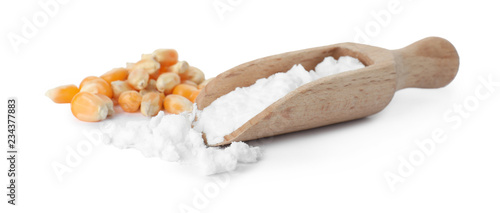 Scoop with corn starch and kernels on white background