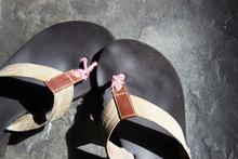 Pair Of Flip Flops On Concrete Floor