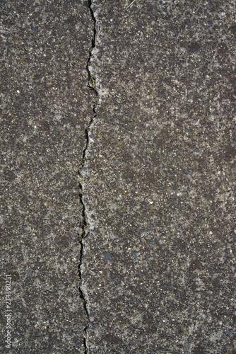 Fotografía  Cracked asphalt in grey color