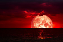 Half Red Blood Moon On Night Sea And Back Silhouette Red Cloud