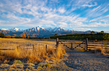 The Sunrises Over The Frosty Farmland Warming Up The Picturesque Landscape And Wooden Farm Gate