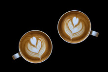 Coffee Latte Art Isolated On Black Background.
