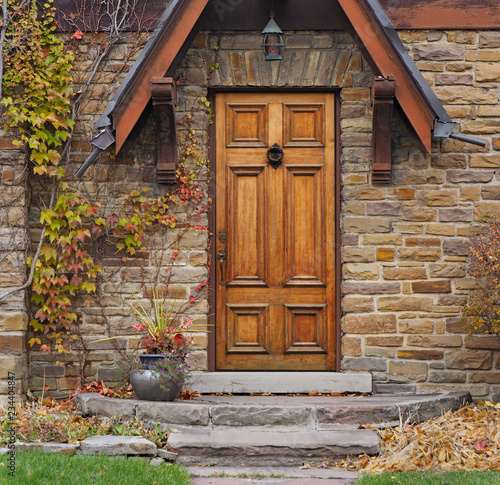 front door of old stone house with ivy