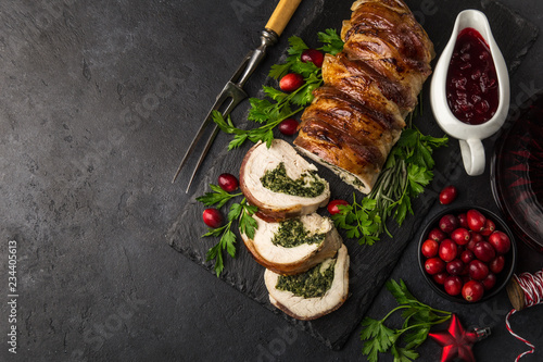Fototapeta bacon wrapped turkey breast stuffed with spinach and cheese for Christmas dinner obraz