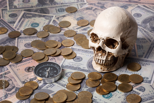 Fotografie, Tablou  Capitalism concept : Skull on banknote, coin ,compass  and vintage map background