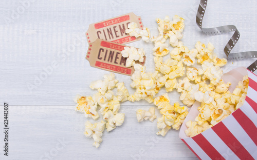 In de dag Buffet, Bar two tickets to the cinema, film and scattered popcorn, on a gray background, with a place for the inscription