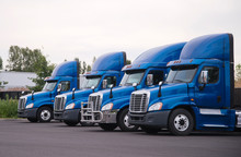Blue Day Cab Big Rig Semi Truck For Local Delivery Stand In Row On The Parking Lot