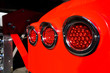 canvas print picture - Rear marker lights in the chrome rim on fender of red big rig semi truck