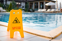 Wet Floor Sign By Luxury Hotel Swimming Pool
