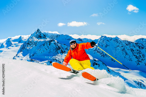 Ski in winter season, mountains and ski touring man on the top in sunny day in France, Alps above the clouds Fototapet