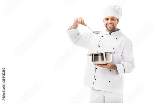 Photo smiling young chef with cooking pot and ladle isolated on white