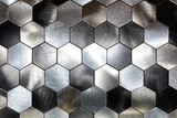 Modern background with a metal hexagons and a black outline. Macro shot - 234430877