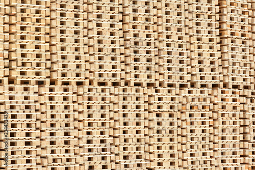 Stacked wooden pallets as background - Buy this stock photo and