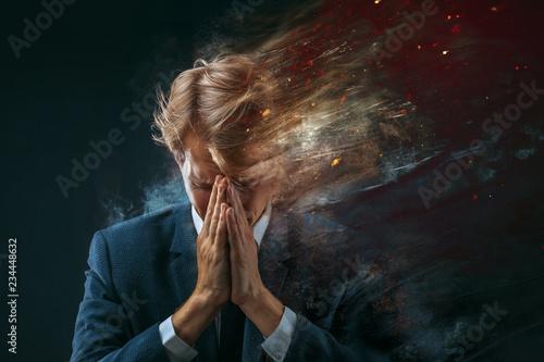 broken businessman. Stress at work, concept. dark background Wallpaper Mural