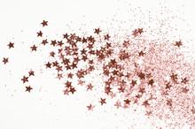 Rose Gold Glitter And Glittering Stars On Light Gray Background