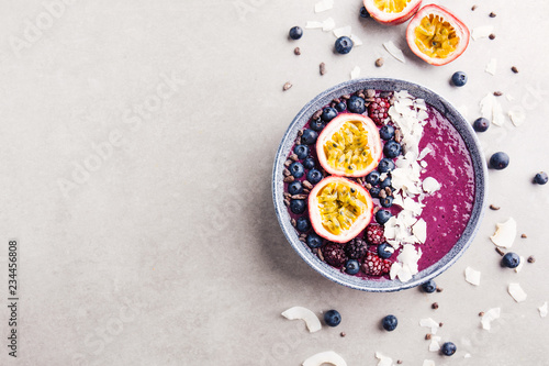 Smoothie acai bowl served in bowl on grey table Canvas Print