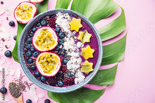 Leinwand Poster Smoothie acai bowl served in bowl on pink table