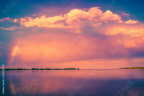 Foto op Aluminium Koraal Beautiful sunset with rainbow over blue lake. Nature landscape background