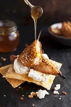 Honey Pouring On Baked Pears Dukkah With Goat Cheese