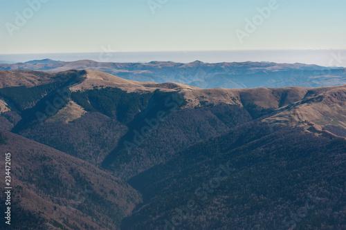Mountain peak in National Park Bucegi of Carpathians mountains seen from Cota 2000, Sinaia Resort, Prahova county, Romania. Autumn season.