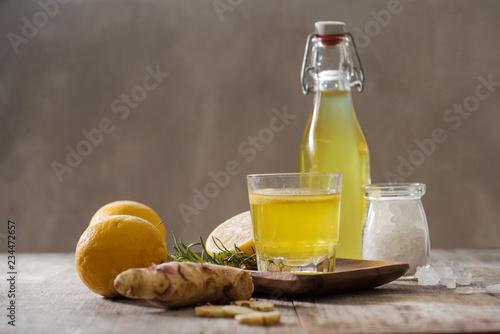 Fotografie, Obraz Homemade lemon and ginger organic probiotic drink, copy space.