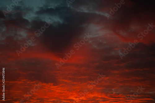 Foto  Bright sunset sky with clouds background