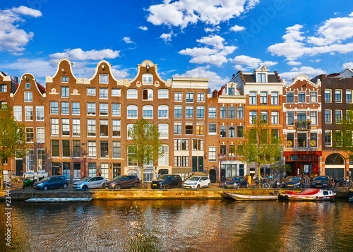 Ingelijste posters Amsterdam Amsterdam Netherlands. Traditional brown house at coast channel