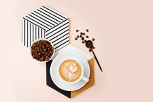 Breakfast With A Cup Of Coffee With A Geometric Decor On Pale Pink Background. Flat Lay, Top View
