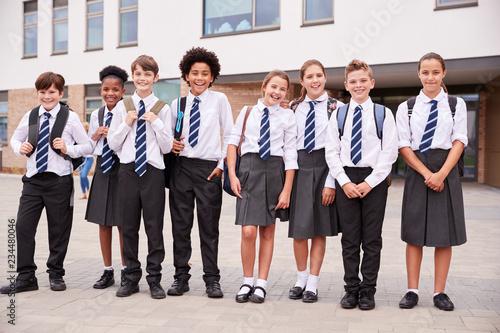 Fotografía  Portrait Of High School Student Group Wearing Uniform Standing Outside School Bu