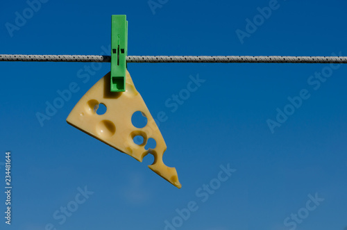 Clothespins, cheese and sky