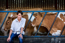 Young Man Sitting In A Barn Wi...