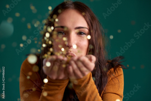Beautiful stylish woman blowing confetti party celebration Wallpaper Mural
