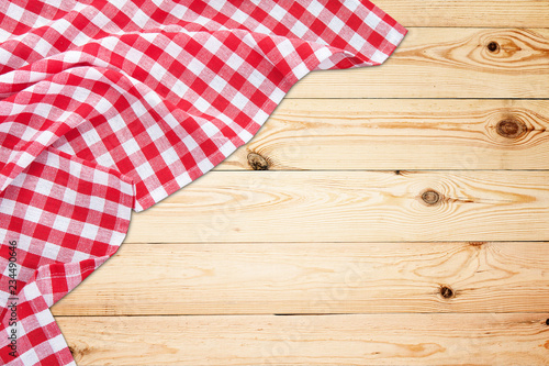 Vintage white wooden table with red checkered tablecloth. Top view mockup.