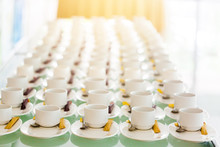 A Lot Of White Coffee Cups And Brown Sugar In The Seminar With Blurred Background.
